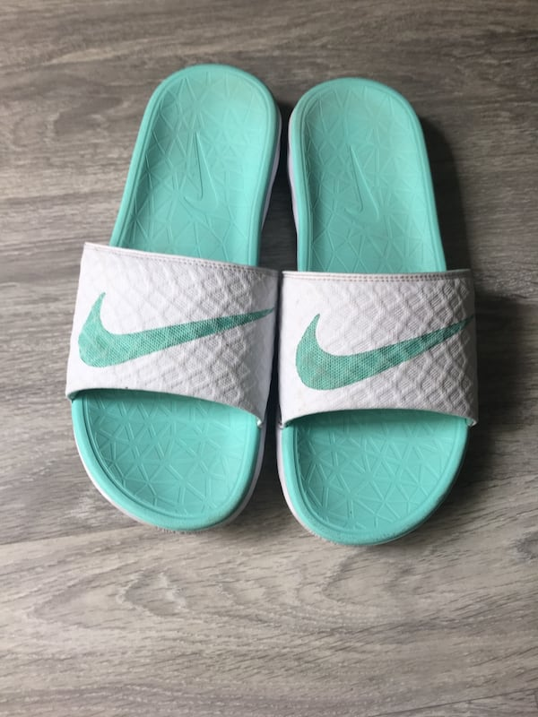 Nike sandals, those are very comfy, clean. 582f0d64-08cf-42aa-8aee-5f6a4387dcbc