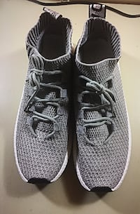 pair of gray Nike running shoes