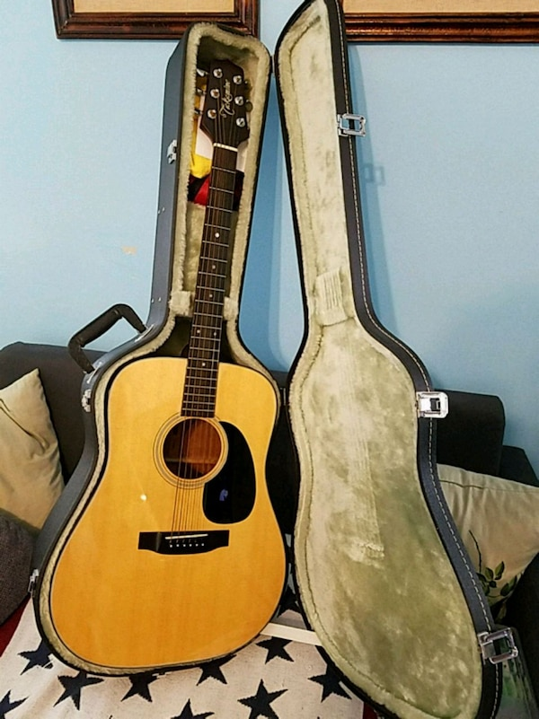 brown dreadnought acoustic guitar in case