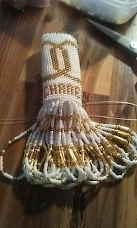 white and gold beaded device