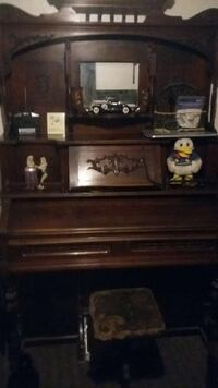 Organ, brown wooden upright.Old pump pedals to pla Peoria, 85345