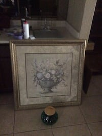 white and pink flower centerpiece still life painting and brass-colored frame