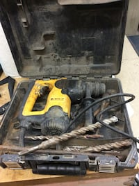 Dewalt corded hammer drill with bits and case D2503. Used