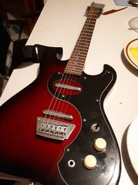 red and black electric guitar null