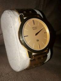 round gold-colored analog watch with black leather strap Edmonton, T6K 3Z8
