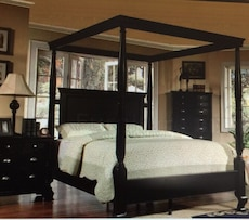 black wooden queen size canopy bed