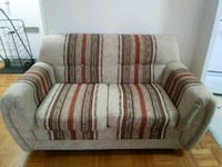 gray and white striped fabric loveseat 549 km