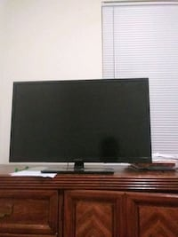 flat screen TV and brown wooden TV stand Virginia Beach, 23462