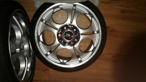 gray 5-spoke vehicle wheel with tire
