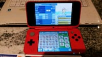 red Nintendo 3DS with game cartridge London, N5X 3Z1
