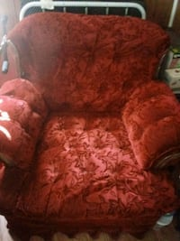 red and brown floral fabric sofa chair