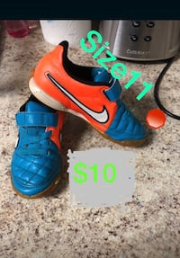 pair of orange-and-blue Nike cleats Gaithersburg, 20878