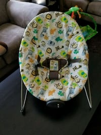 baby's white and green bouncer Edmonton, T6W