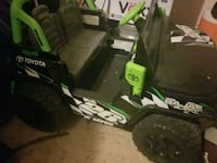 green and black Kawasaki ATV