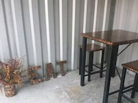 brown wooden framed glass top side table