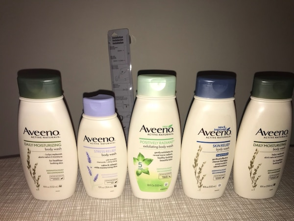 four Pantene shampoo and conditioner bottles
