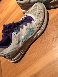 pair of gray-and-purple Nike running shoes Westmount, H3Y 2K9