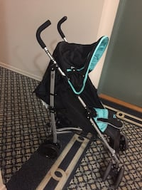 baby's black and teal stroller