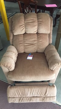 brown cushion glider chair