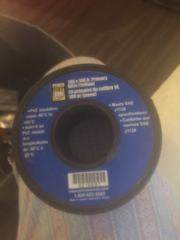 blue and black Sony PS2 game disc
