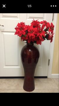Red flowers in bamboo vase Fremont, 94555