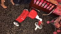 toddler's red and white trike