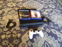 Black PS4 with 2 games 42 km