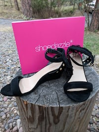 pair of black leather open-toe wedges null