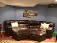 Curved Sectional with 2 Storage Ottomans  Caledon
