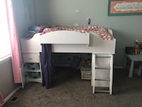 White twin sized loft bed with cabinet and dresser