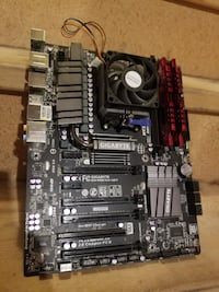 3 mother boards, with CPUs and memory + cases FREE