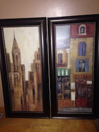 two paintings of Chrysler building and hotel facade with brown wooden frames