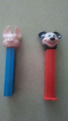 two assorted PEZ candy dispensers