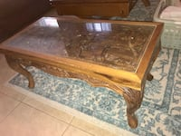 Phillipine hand carved coffee table w/ glass top. Orlando