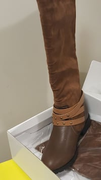 pair of brown knee-high riding boots. Size 10 Oxon Hill, 20745