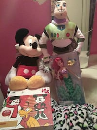 Buzz Light Year, Mickey Mouse, and Little Mermaid plush toys