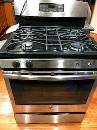 Silver GE Gas range oven w/self cleaning feature Bristow, 20136