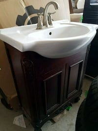 Vanity with faucet and matching mirror
