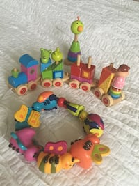 Toddler's assorted wooden toys and rubber bugs !