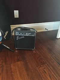 black and gray squire guitar amplifier