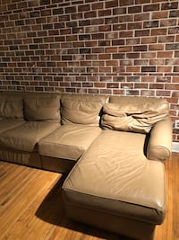 """Leather couch about 8' 3"""" in length Charlotte, 28202"""