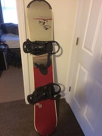 gray and red snowboard with bindings Durham, 03824