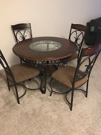 round black metal table with four chairs dining set 2285 mi