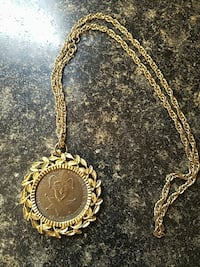 round gold-colored pendant necklace