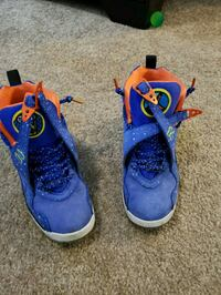 pair of blue-and-red Nike basketball shoes