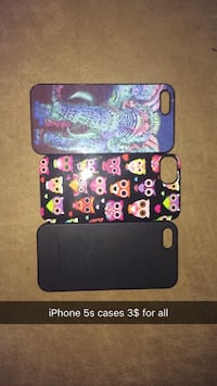 three assorted iPhone cases and two black iPhone cases
