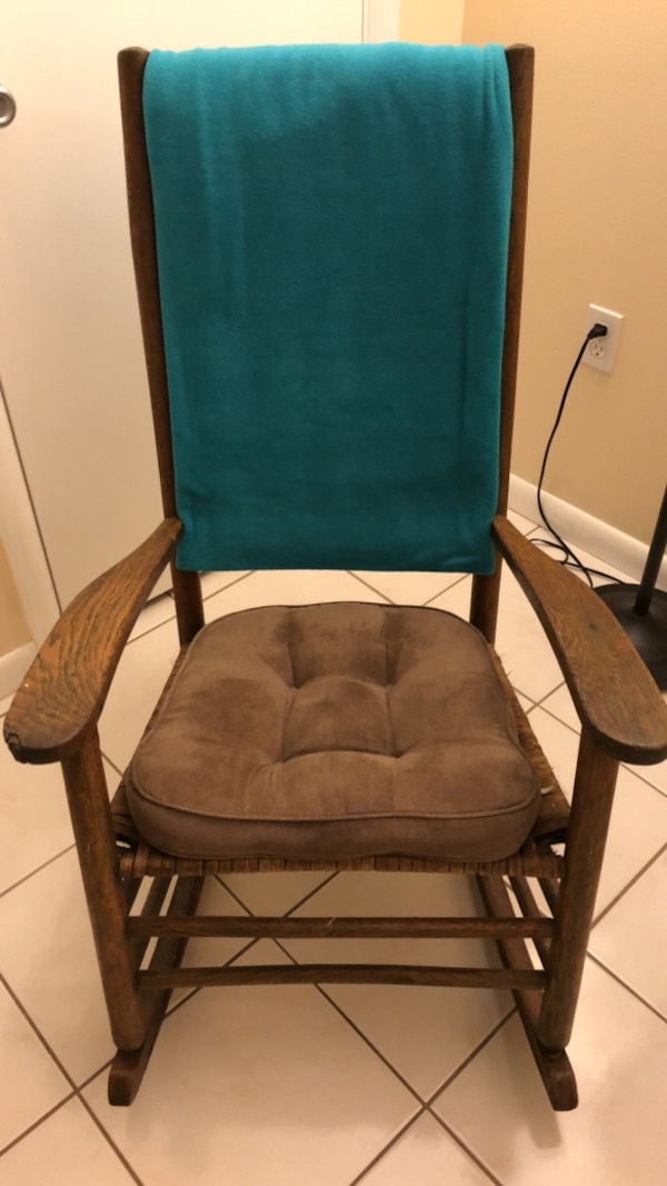 Brown Wood Rocking Chair With Cushion And Throw