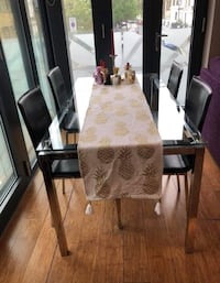 Glass table with 4 black leather chairs null, W11 1AD