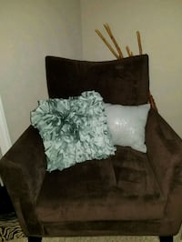 Brown chair with pillows.  Charlotte