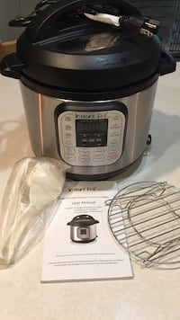 Gray and black instant pot pressure cooker